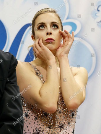 Ashley Wagner waits for her scores during the women's free skate event at the U.S. Figure Skating Championships in San Jose, Calif