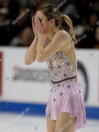 Ashley Wagner reacts after performing during the women's free skate event at the U.S. Figure Skating Championships in San Jose, Calif