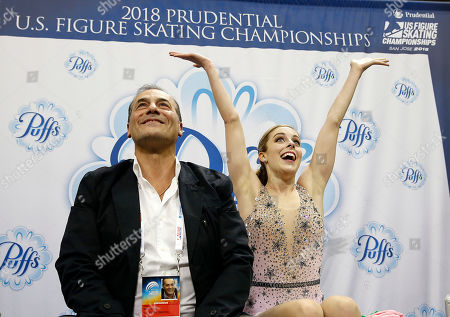 Ashley Wagner, right, reacts to her scores next to coach Rafael Arutunian during the women's free skate event at the U.S. Figure Skating Championships in San Jose, Calif