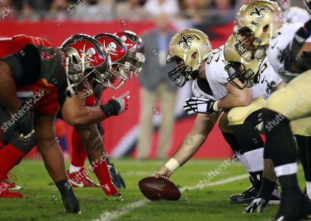 New Orleans Saints center Max Unger (60) readies himself against the Tampa Bay Buccaneers during an NFL football game, in Tampa, Fla. The Buccaneers won the game 31-24