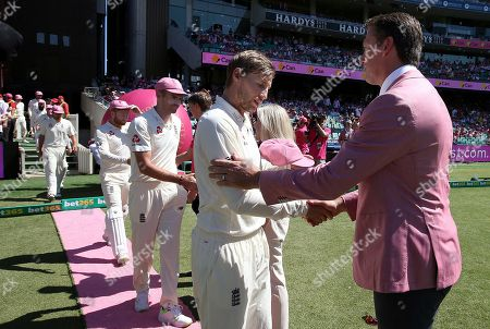 Joe Root, Glenn McGrath. England's Joe Root, center, leads his team in presenting signed hats for charity to former Australian player Glenn McGrath, right, during the third day of their Ashes cricket test match in Sydney