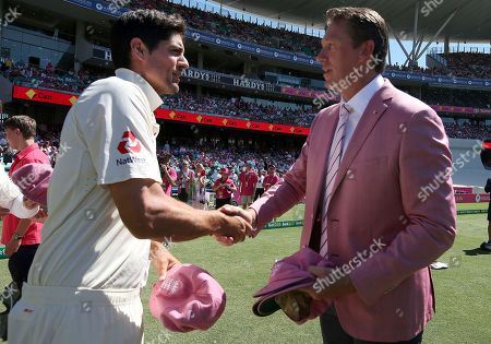 Alastair Cook, Glenn McGrath. England's Alastair Cook, left, presents a signed hat for charity to former Australian player Glenn McGrath, right, during the third day of their Ashes cricket test match in Sydney