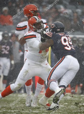 Shon Coleman, Lamarr Houston. Cleveland Browns offensive tackle Shon Coleman (72) blocks Chicago Bears linebacker Lamarr Houston (99) during an NFL football game in Chicago, . The Bears defeated the Browns 20-3