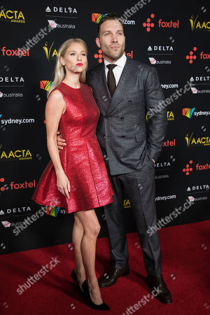 Jai Courtney, Mecki Dent. Jai Courtney, right, and Mecki Dentfor pose for photographers upon arrival at the 7th annual AACTA International Awards at the Avalon, in Los Angeles