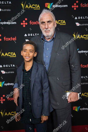 Phillip Noyce, Luvuyo Noyce. Phillip Noyce and Luvuyo Noyce pose for photographers upon arrival at the 7th annual AACTA International Awards at the Avalon, in Los Angeles