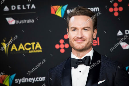 Josh Lawson poses for photographers upon arrival at the 7th annual AACTA International Awards at the Avalon, in Los Angeles