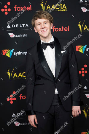 Josh Thomas poses for photographers upon arrival at the 7th annual AACTA International Awards at the Avalon, in Los Angeles