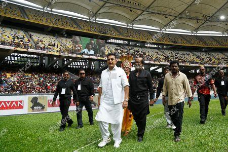 Rajinikanth, Kamal Haasan. Indian movie superstars Kamal Haasan, center in white, and Rajinikanth, center in black, arrive at an event in Kuala Lumpur, Malaysia