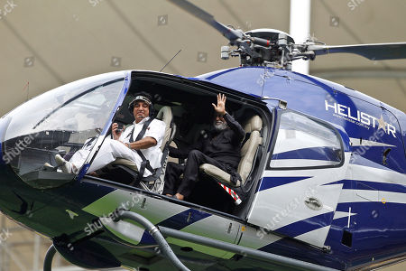 Rajinikanth, Kamal Haasan. Indian movie superstars Kamal Haasan, front seat, and Rajinikanth, back seat, waves to the fans as they arrive at an event in Kuala Lumpur, Malaysia