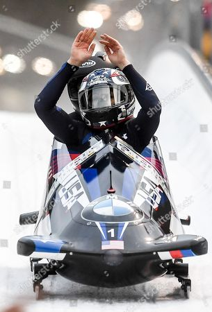 Second placed Jamie Poser Greubel and Aja Evans of  the USA celebrate after the second run of the Women's race at the Bobsleigh World Cup in Altenberg, Germany, 06 January 2018.
