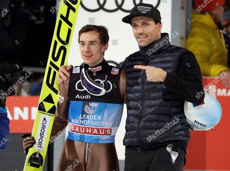 Poland's overall winner Kamil Stoch, left, and Germany's former ski jumper Sven Hannawald, right, who won all four stages of the Four Hills ski jumping event in 2002, pose after the Four Hills Ski Jumping event at the ski jump in Bischofshofen, Austria