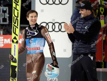 Poland's overall winner Kamil Stoch, left, is congratulated by Germany's former ski jumper Sven Hannawald, right, who won all four stages of the Four Hills ski jumping event in 2002, after the Four Hills Ski Jumping event at the ski jump in Bischofshofen, Austria