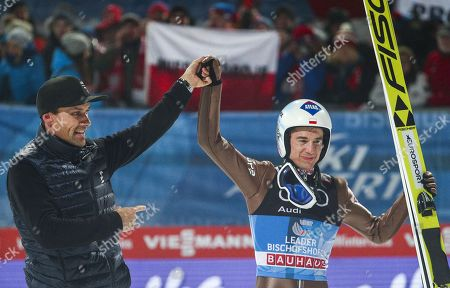 Winner Kamil Stoch (R) of Poland and former German ski jumper and Four Hills Grand Slam winner Sven Hannawald (L) react after the fourth stage of the 66th Four Hills Tournament in Bischofshofen, Austria, 06 January 2018