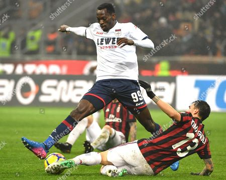 Stock Photo of Fc Crotones forward Simy Simeon Tochukwu Nwankwo (L) and AC Milans defender Alessio Romagnoli struggle for the ball during the Serie A soccer match between AC Milan and FC Crotone at the Giuseppe Meazza stadium in Milan, Italy, 6 January 2018.