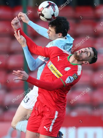 Cliftonville vs Warrenpoint Town. Cliftonville's Joe Gormley in action with Warrenpiont Town's Danny Wallace
