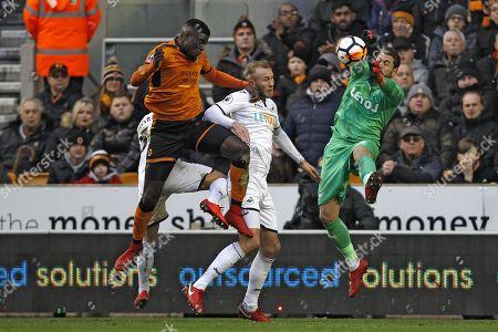 Kristoffer Nordfeldt of Swansea City (right) saves from Alfred N'Diaye of Wolverhampton Wanderers (left)