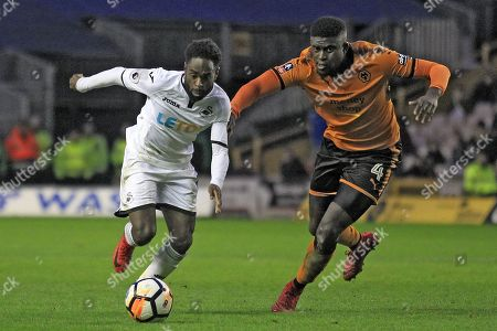 Nathan Dyer of Swansea City (left) in action with  Alfred N'Diaye of Wolverhampton Wanderers