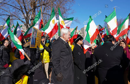 Former House Speaker Newt Gingrich, center, makes his way to the podium to speak at a rally across from the White House in Washington,, in solidarity with anti-government demonstrators in Iran. Iran has seen its largest anti-government protests since the disputed presidential election in 2009