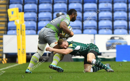 Greig Tonks of London Irish with the tackle on Vereniki Goneva of Newcastle Falcons during the Aviva Premiership Rugby match between London Irish v Newcastle Falcons on December 30th 2017 at Madejski Stadium, Reading, Berkshire England. (Photo by Gareth Davies/PPAUK)