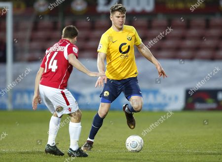Torquay United player Axel Oscar Andresson attacks Wrexham player Paul Rutherford during the Vanarama National League Match between Wrexham and Torquay United at The Racecourse Ground, Wrexham on January 6.