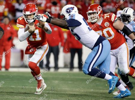 David King, Alex Smith. Tennessee Titans defensive end David King (95) chases Kansas City Chiefs quarterback Alex Smith (11) during the second half of an NFL wild-card playoff football game, in Kansas City, Mo