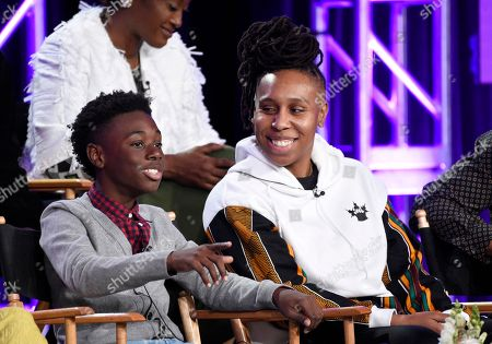 """Alex Hibbert, Lena Waithe. Alex Hibbert, left, a cast member in the Showtime series """"The Chi,"""" answers a reporter's question as the show's creator/executive producer/writer Lena Waithe looks on during a panel discussion at the Television Critics Association Winter Press Tour, in Pasadena, Calif"""