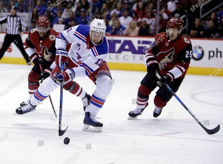 New York Rangers center Kevin Hayes (13) skates between Arizona Coyotes left wing Anthony Duclair, left, and Nick Cousins (25) in the third period during an NHL hockey game, in Glendale, Ariz