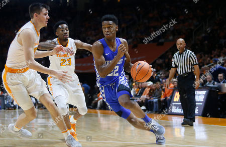 Shai Gilgeous-Alexander, John Fulkerson, Jordan Bowden. Kentucky guard Shai Gilgeous-Alexander (22) is defended by Tennessee forward John Fulkerson, left, and guard Jordan Bowden (23) during the first half of an NCAA college basketball game, in Knoxville, Tenn