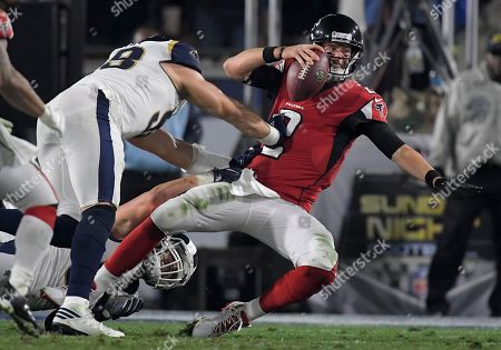Atlanta Falcons quarterback Matt Ryan, right, is sacked by Los Angeles Rams outside linebacker Connor Barwin during the first half of an NFL football wild-card playoff game, in Los Angeles