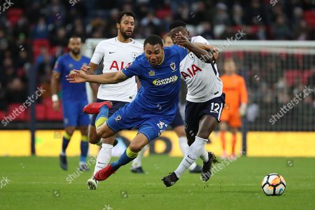 Victor Wanyama of Tottenham Hotspur (12)  fouling AFC Wimbledon defender Darius Charles (32) during the The FA Cup 3rd round match between Tottenham Hotspur and AFC Wimbledon at Wembley Stadium, London