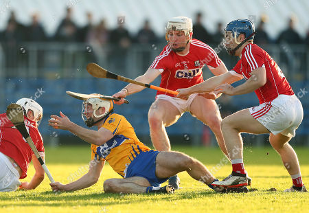 Clare vs Cork. Cork's David Griffin and Chris O Leary with Conor McGrath of Clare