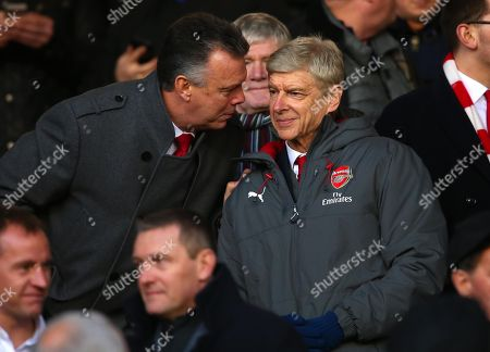 Former Arsenal player David O'Leary speaks with Arsenal manager Arsene Wenger