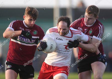 Tyrone vs St. Mary's. Tyrone's Ronan McNabb and St. Mary's Stephen McConville and Oisin O'Neill