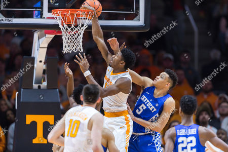 Kyle Alexander #11 of the Tennessee Volunteers is fouled by Kevin Knox #5 of the Kentucky Wildcats during the NCAA basketball game between the University of Tennessee Volunteers and the University of Kentucky Wildcats at Thompson Boling Arena in Knoxville TN Tim Gangloff/CSM