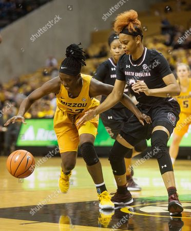 Lele Grissett, Amber Smith. Missouri's Amber Smith, left, and South Carolina's Lele Grissett, right, battle for the ball during the first half of an NCAA college basketball game, in Columbia, Mo