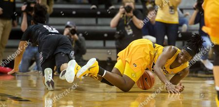 Amber Smith, Tyasha Harris. Missouri's Amber Smith, right, falls to the court after she is fouled by South Carolina's Tyasha Harris, left, during the second half of an NCAA college basketball game, in Columbia, Mo. Missouri won 83-74
