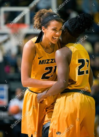 Cierra Porter, Amber Smith. Missouri's Cierra Porter, left, laughs with teammate Amber Smith late in the second half of an NCAA college basketball game against South Carolina, in Columbia, Mo. Missouri won 83-74