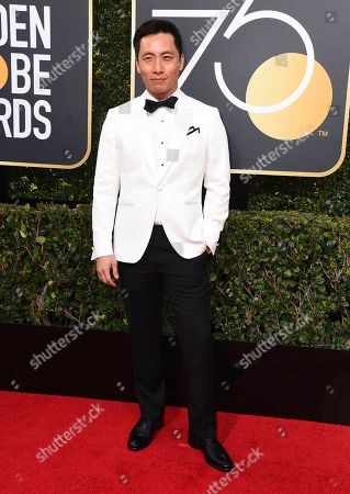 Kelvin Yu arrives at the 75th annual Golden Globe Awards at the Beverly Hilton Hotel, in Beverly Hills, Calif