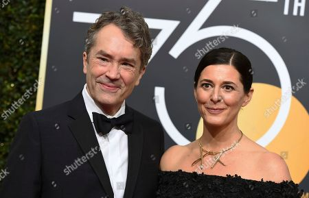 Carter Burwell, Christine Sciulli. Carter Burwell, left, and Christine Sciulli arrive at the 75th annual Golden Globe Awards at the Beverly Hilton Hotel, in Beverly Hills, Calif