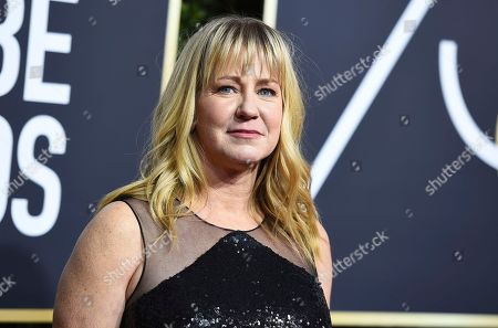 Tonya Harding arrives at the 75th annual Golden Globe Awards at the Beverly Hilton Hotel, in Beverly Hills, Calif