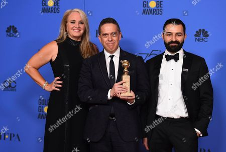 """Darla K. Anderson, Lee Unkrich, Adrian Molina. Darla K. Anderson, from left, Lee Unkrich and Adrian Molina pose in the press room with the award for best motion picture - animated for """"Coco"""" at the 75th annual Golden Globe Awards at the Beverly Hilton Hotel, in Beverly Hills, Calif"""