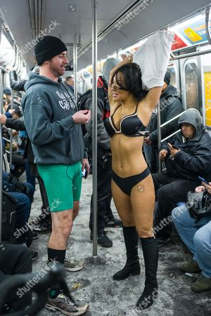 Rick McGuire and Asa Akira participate in the annual No Pants Subway Ride in New York City hosted by Improv Everywhere on Jan. 7, 2018