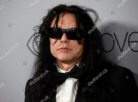 Tommy Wiseau arrives at the InStyle and Warner Bros. Golden Globes afterparty at the Beverly Hilton Hotel, in Beverly Hills, Calif