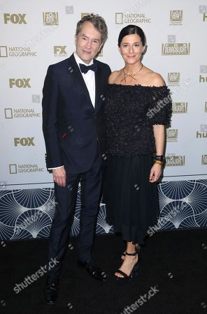 Carter Burwell, Christine Sciulli. Carter Burwell, left, and Christine Sciulli arrive at the FOX Golden Globes afterparty at the Beverly Hilton Hotel, in Beverly Hills, Calif