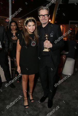 Addison Riecke and Gary Oldman