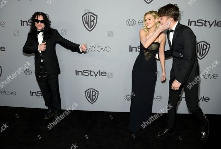 Tommy Wiseau, Nicola Peltz, Anwar Hadid. Tommy Wiseau, from left, Nicola Peltz and Anwar Hadid arrive at the InStyle and Warner Bros. Golden Globes afterparty at the Beverly Hilton Hotel, in Beverly Hills, Calif