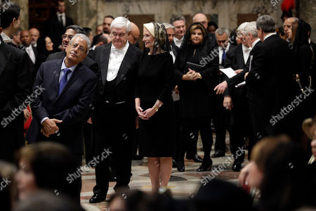 """Callista Gingrich, Newt Gingrich. U.S. Ambassador to the Holy See Callista Gingrich, center, and her husband Newt Gingrich at her right, stand in a line to meet Pope Francis during an audience with diplomats accredited to the Holy See for the traditional exchange of New Year greeting, in the """"Regia"""" hall at the Vatican"""