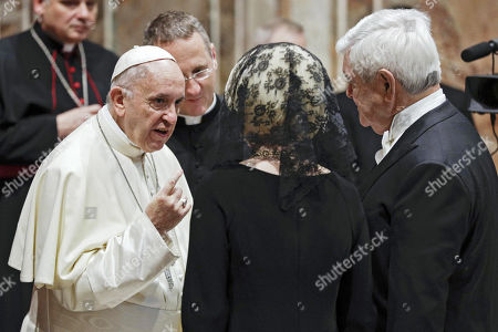 US Ambassador to the Holy See Callista Gingrich (C) and her husband Newt Gingrich (R) meet Pope Francis (L) during an audience with diplomats accredited to the Holy See for the traditional exchange of New Year greeting, in the Regia hall at the Vatican, 08 January 2018.