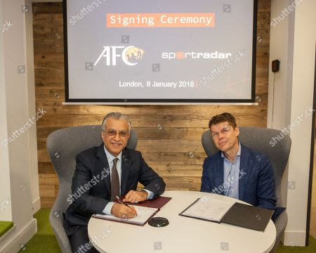 Stock Picture of Asian Football Confederation President Shaikh Salmam bin Ebrahim Al Khalifa joins Sportradar Chief Executive Carsten Koerl sign the agreement for an historic partnership in the field of integrity, specifically addressing match fixing.