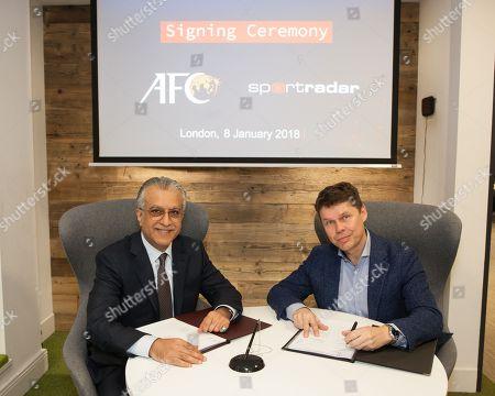 Asian Football Confederation President Shaikh Salmam bin Ebrahim Al Khalifa joins Sportradar Chief Executive Carsten Koerl sign the agreement for an historic partnership in the field of integrity, specifically addressing match fixing.